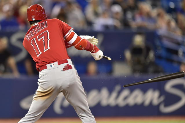 Los Angeles Angels' Shohei Ohtani breaks his bat as he hits a single scoring Mike Trout and Justin Upton to tie the score during the ninth inning of a baseball game against the Toronto Blue Jays in Toronto on Wednesday, May 23, 2018. (Frank Gunn/The Canadian Press via AP)