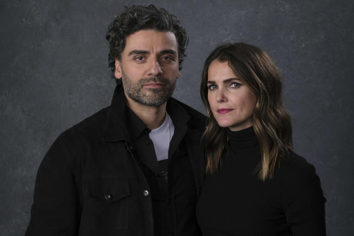 """This Dec. 3, 2019 photo shows Keri Russell, right, and Oscar Isaac posing for a portrait to promote their film """"Star Wars: The Rise of Skywalker"""" in Pasadena, Calif. (AP Photo/Chris Pizzello)"""