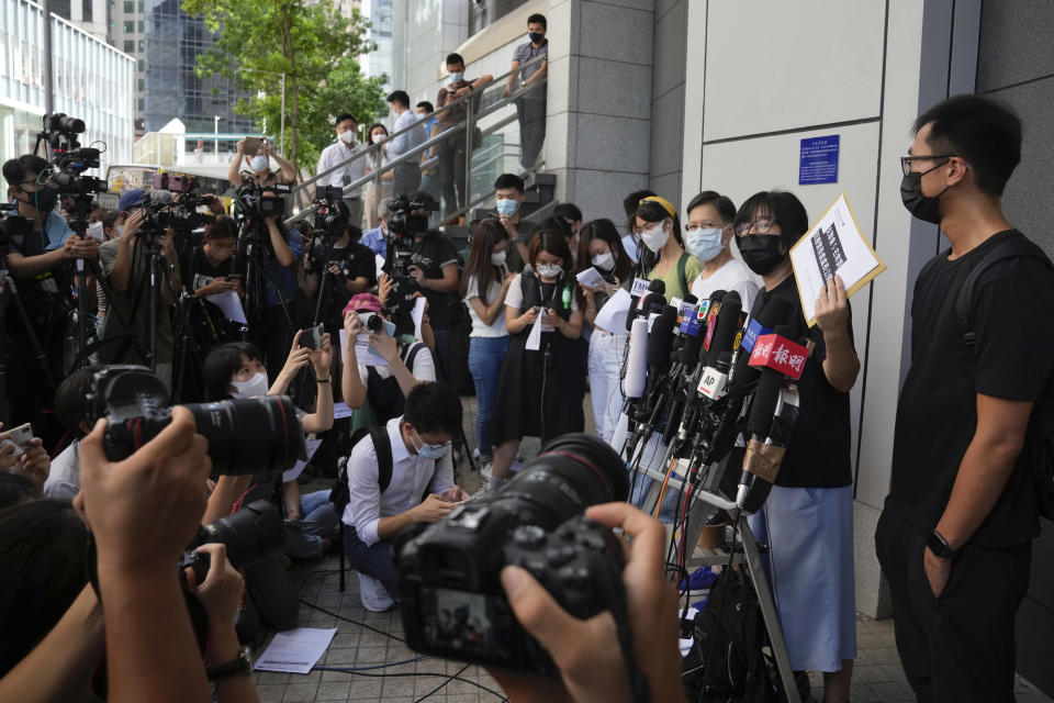 Chow Han Tung, vice chairwoman of the Hong Kong Alliance in Support of Patriotic Democratic Movements of China, second right, accompanied with other committee members, speaks to media before delivering a letter to the police to reject their information request at the police headquarters in Hong Kong, Tuesday, Sept. 7, 2021. The group said the Hong Kong government is arbitrarily labeling pro-democracy organizations as foreign agents so they can be prosecuted under a tough national security law, Tuesday. (AP Photo/Kin Cheung)