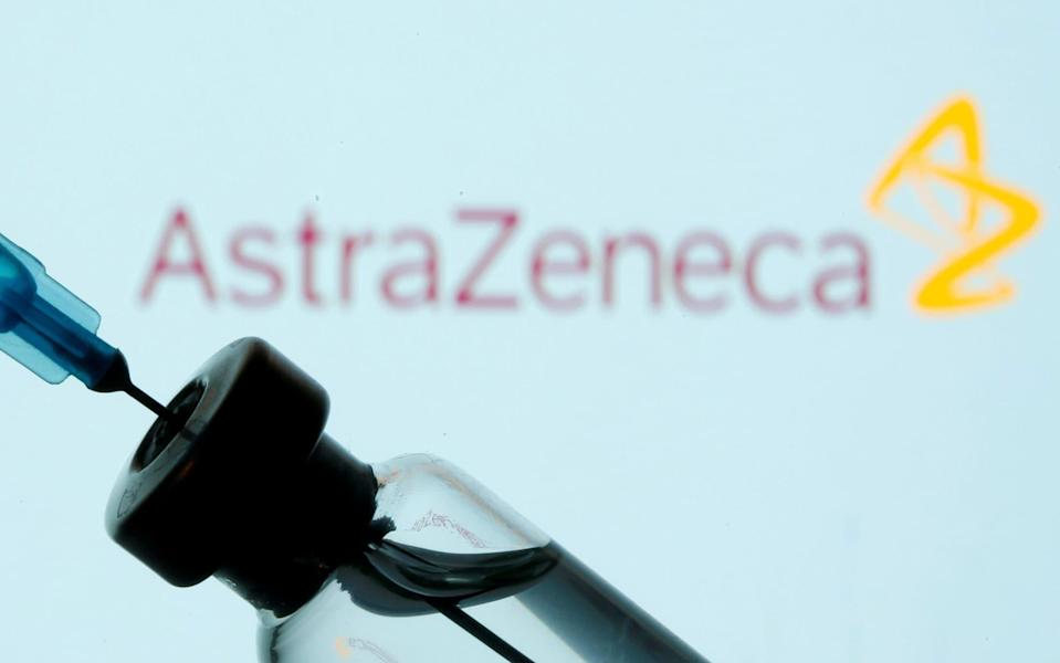 A vial and sryinge are seen in front of a displayed AstraZeneca logo in this illustration taken January 11, 2021. REUTERS/Dado Ruvic/Illustration/File Photo - Dado Ruvic/REUTERS