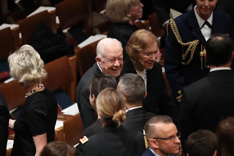 Former President Jimmy Carter, center, and former U.S. First Lady Rosalynn Carter arrive to a state funeral service for former President George H.W. Bush at the National Cathedral in Washington, D.C., on Wednesday, Dec. 5, 2018. (Photo: Andrew Harrer/Bloomberg via Getty Images