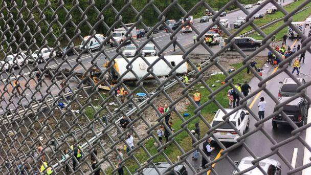 PHOTO: Vehicles stop at the scene where a school bus collided with a dump truck near Mount Olive Township, N.J., May 17, 2018. (Obtained by ABC News)
