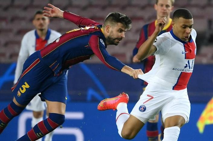 Gerard Pique's attempt, in vain, to halt Kylian Mbappe by tugging at the Frenchman's shirt summed up Barcelona's helplessness against the PSG superstar