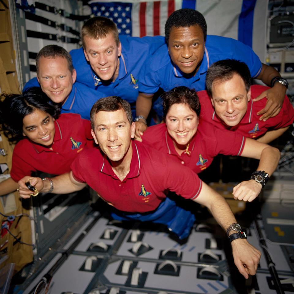 FILE - This photo provided by NASA in June 2003 shows STS-107 crew members,from the left (bottom row), wearing red shirts to signify their shift's color, are astronauts Kalpana Chawla, mission specialist; Rick D. Husband, mission commander; Laurel B. Clark, mission specialist; and Ilan Ramon, payload specialist. From the left (top row), wearing blue shirts, are astronauts David M. Brown, mission specialist; William C. McCool, pilot; and Michael P. Anderson, payload commander. The astronauts were killed on Feb. 1, 2003, in the final minutes of their 16-day scientific research mission aboard Columbia. Altogether, 12 children lost a parent aboard Columbia. The youngest is now 15, the oldest 32. (AP Photo/NASA, File)