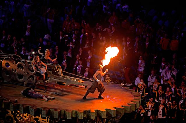 LONDON, ENGLAND - SEPTEMBER 09: A performer breathes fire during the closing ceremony on day 11 of the London 2012 Paralympic Games at Olympic Stadium on September 9, 2012 in London, England. (Photo by Dennis Grombkowski/Getty Images)