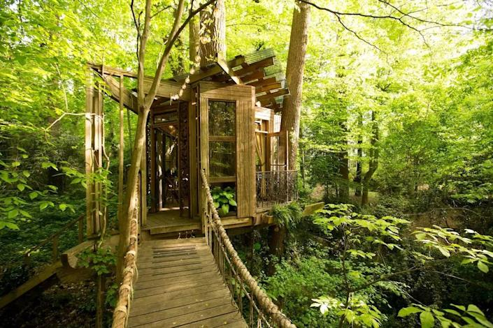 """<p><strong>Atlanta, Georgia</strong></p> <p>For the spiritually inclined, or those looking to get more in touch with their senses on their next getaway, the Secluded In-Town Treehouse has a """"mind, body, spirit"""" theme: The sitting room is the """"mind,"""" the bedroom is the """"body,"""" and the hammock is the """"spirit."""" The treehouse, propped up on a 165-year-old southern shortleaf pine tree and surrounded by rope bridges, has huge windows for daylong gaping out at the stunning Sacred Forest.</p> $389, Airbnb. <a href=""""https://www.airbnb.com/rooms/1415908"""" rel=""""nofollow noopener"""" target=""""_blank"""" data-ylk=""""slk:Get it now!"""" class=""""link rapid-noclick-resp"""">Get it now!</a>"""