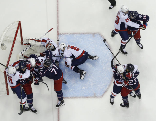 Washington Capitals and Columbus Blue Jackets players scuffle in front of the net during the second period of Game 4 of an NHL first-round hockey playoff series Thursday, April 19, 2018, in Columbus, Ohio. (AP Photo/Jay LaPrete)