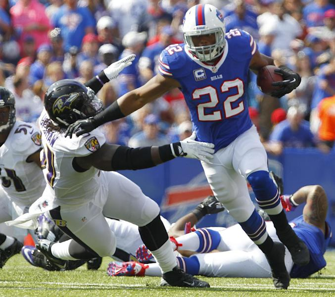 Buffalo Bills running back Fred Jackson (22) runs past Baltimore Ravens outside linebacker Courtney Upshaw (91) during the first half of an NFL football game on Sunday, Sept. 29, 2013, in Orchard Park, N.Y. (AP Photo/Bill Wippert)