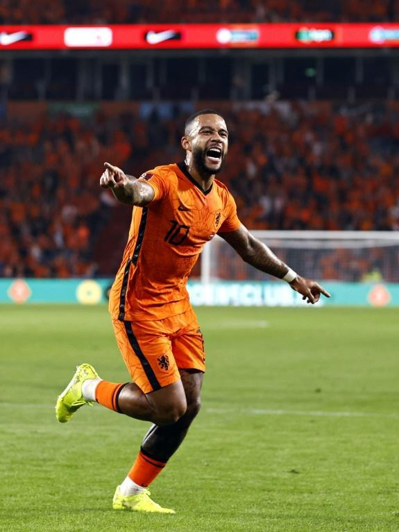 Memphis Depay celebrates his second goal against Montenegro in a 4-0 win (AFP/MAURICE VAN STEEN)