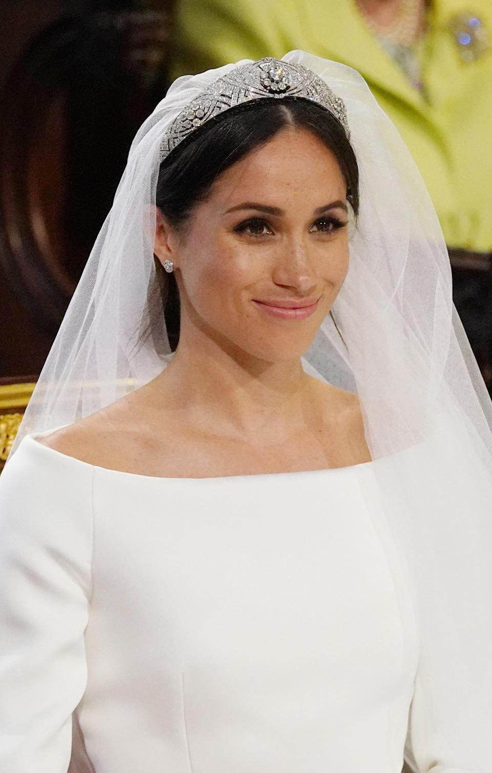 <p>Meghan Markle accessorized with earrings and a bracelet from Cartier. JONATHAN BRADY/AFP/Getty Images </p>