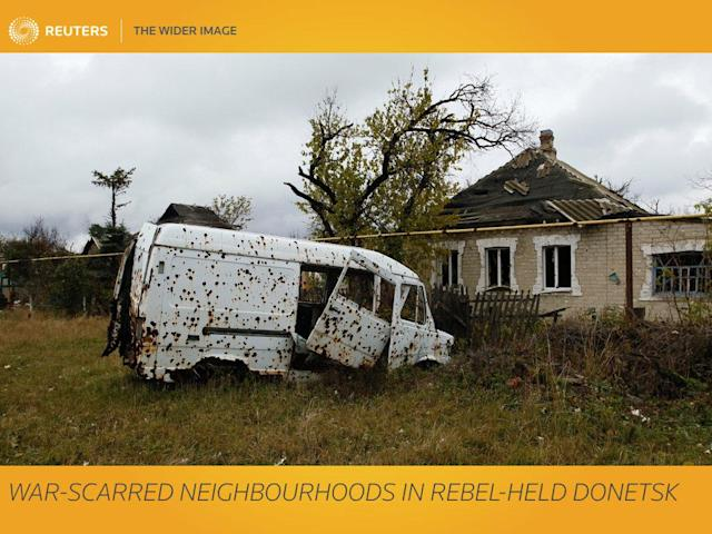 "Ruined houses, shell craters and deserted streets - this is a typical scene in the Oktyabrsky district of Donetsk, the largest city of Ukraine's pro-Russian rebel region that bears the same name. The self-styled Donetsk and next-door Luhansk ""people's republics"" broke away from central rule in 2014 after months of violent street protests in Kiev toppled Ukraine's Moscow-leaning president and propelled pro-Western nationalists to power. In this calm suburb of Donetsk, many people stood aloof of politics. But then fierce clashes broke out between Ukrainian government troops and pro-Russian separatists for control over the nearby Donetsk Airport. A glistening air hub of steel and glass, specially built for the UEFA Euro 2012 of which Donetsk was a venue, the local airport was levelled to the ground, and many of the buildings in Oktyabrsky shared its fate. REUTERS/Alexander Ermochenko SEARCH ""ERMOCHENKO DAMAGE"" FOR THIS STORY. SEARCH ""WIDER IMAGE"" FOR ALL STORIES. TPX IMAGES OF THE DAY. Matching text: UKRAINE-CRISIS/DONETSK-DWELLERS"