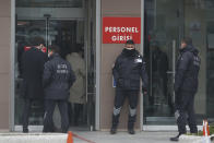 Security personnel guard the entrance to Istanbul's court Wednesday, Feb. 24, 2021, where the case of a Turkish private airline official and two pilots over their involvement in former Nissan Motor Co. chairman Carlos Ghosn's dramatic escape out of Japan in 2019 and to Beirut, Lebanon, was held. The court convicted a Turkish private airline official and two pilots and sentenced them each to four years and two months in prison. Ghosn, who was arrested over financial misconduct allegations in Tokyo in 2018, skipped bail while awaiting trial there. (AP Photo/Mehmet Guzel)