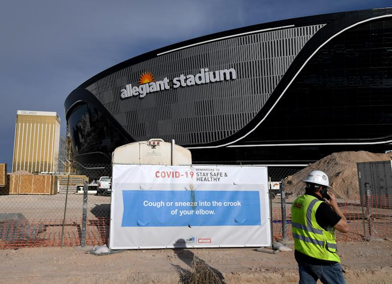 A sign with guidelines for how to stay safe from the coronavirus is posted on a fence at Allegiant Stadium as construction continued on the Raiders' new home. (Photo by Ethan Miller/Getty Images)