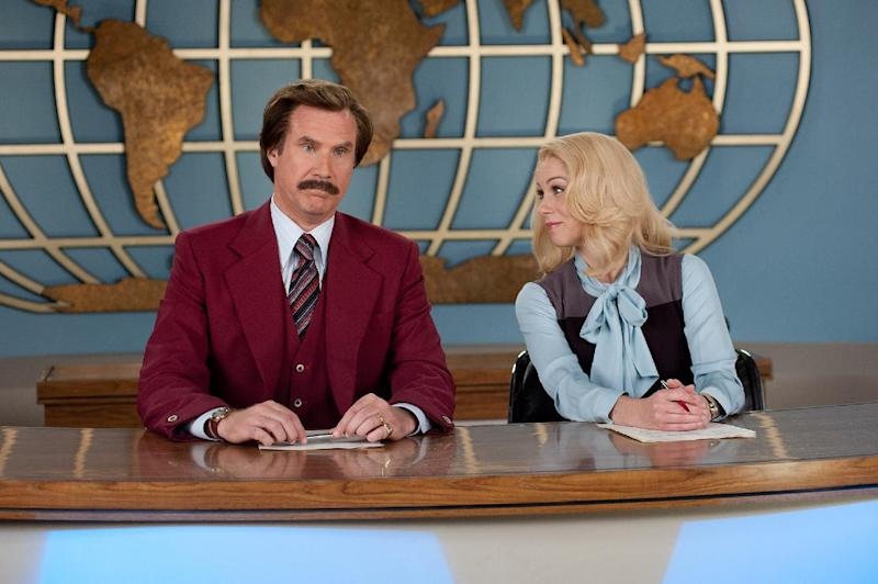 "This image released by Paramount Pictures shows Will Ferrell as Ron Burgundy, left, and Christina Applegate as Veronica Corningstone in a scene from ""Anchorman 2: The Legend Continues."" ""The Hobbit: The Desolation of Smaug"" held off ""Anchorman 2"" on a busy weekend at the box office. According to studio estimates Sunday, Peter Jackson's ""Hobbit"" sequel took in $31.5 million in its second weekend of release. That topped Will Ferrell's ""Anchorman"" sequel, which nevertheless opened strongly in second place. (AP Photo/Paramount Pictures, Gemma LaMana)"