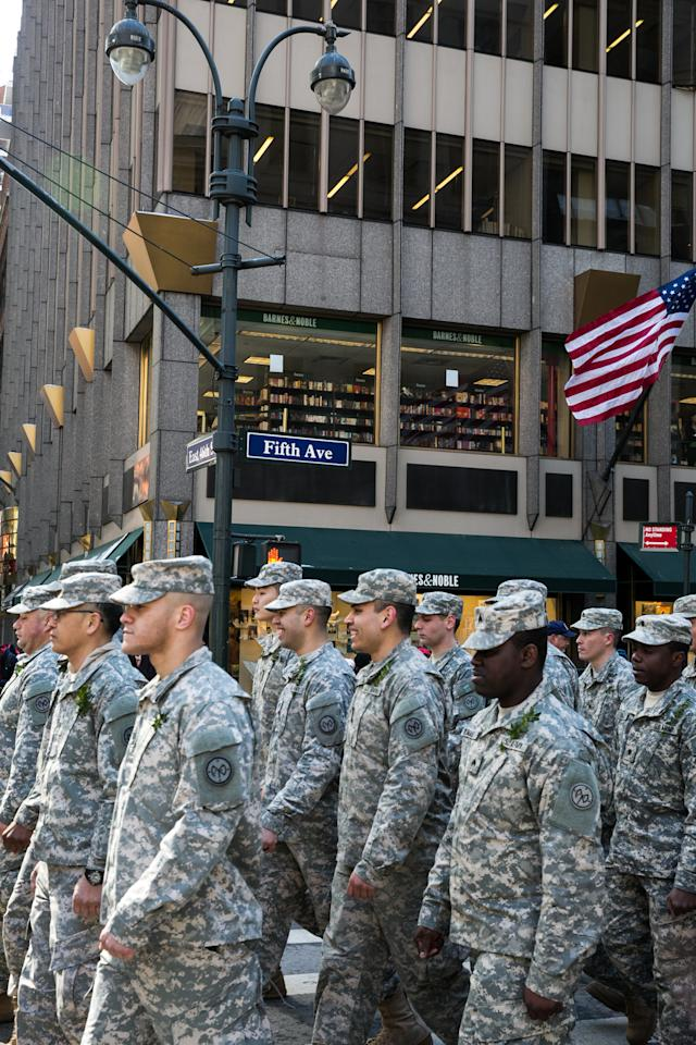 <p>The U.S. military, in camouflage green, walks down NYC's Fifth Ave. in the St. Patrick's Day Parade. (Photo: Casey Hollister/Yahoo Style) </p>