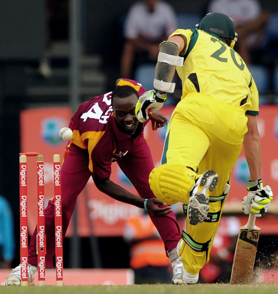 West Indies cricketer Kemar Roach (L) attempts to dismiss Australian batsman Ben Hilfenhaus during the fifth-of-five One Day International (ODI) matches between West Indies and Australia at the Beausejour Cricket Ground in Gros Islet, St. Lucia on March 25, 2012.     AFP PHOTO/Jim Watson (Photo credit should read JIM WATSON/AFP/Getty Images)