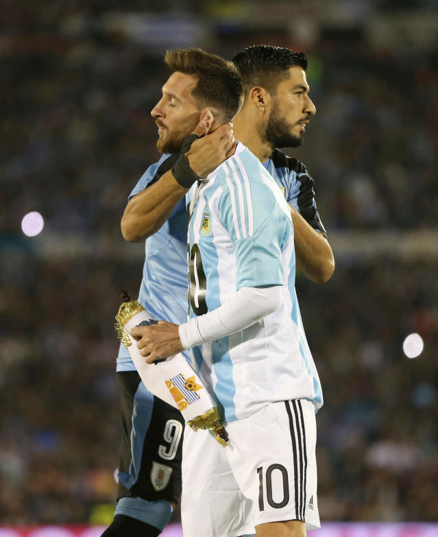 FILE - In this Thursday, Aug. 31, 2017 file photo, Argentina's Lionel Messi and Uruguay's Luis Suarez greet before a 2018 World Cup qualifying soccer match in Montevideo, Uruguay. (AP Photo/Natacha Pisarenko, File)