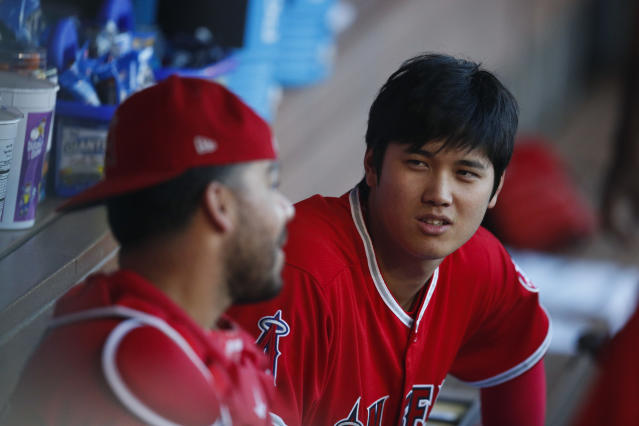 Los Angeles Angels phenom Shohei Ohtani (right) is quickly finding his place in the clubhouse. (AP Photo/Jae C. Hong)