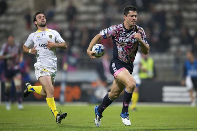 Stade Francais' winger Guillaume Bousses (R) scores to score a try despite Clermont's scrum-half Morgan Parra during the European Challenge Cup semi final rugby union match Stade Francais vs. Clermont at the Charlety stadium in Paris on April 29, 2011. AFP PHOTO / BERTRAND LANGLOIS (Photo credit should read BERTRAND LANGLOIS/AFP/Getty Images)