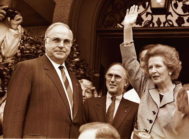 <p>Former British Prime Minister Margaret Thatcher waves to well wishers as German Chancellor Helmut Kohl (L) looks on during Thatcher's visit to Germany, Sept. 23, 1998. (Reuters) </p>
