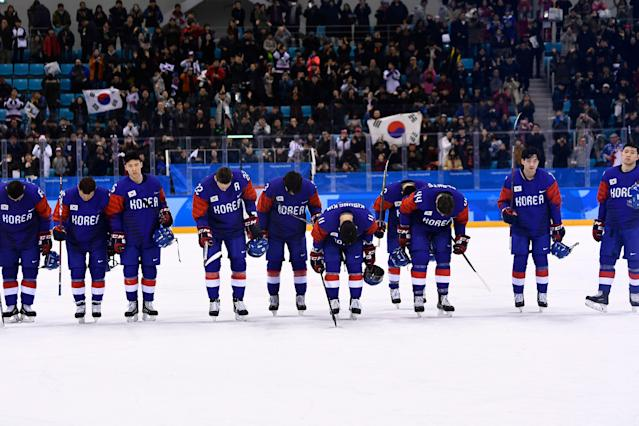 Team South Korea bows after losing a men's preliminary round ice hockey match between South Korea and Switzerland. Brendan Smialowski/AFP/Getty Images)