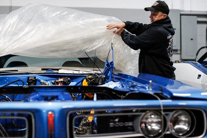 Dave Dudek takes the cover off a 1971 Dodge Charger R/T at Dave Dudek Muscle Cars garage in Clinton Township, Tuesday, Jan. 7, 2020.
