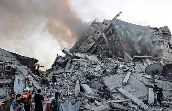 People stand amid rubble.