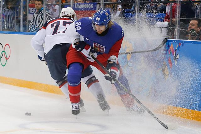 Czech Republic forward Jakub Voracek takes control of the puck from USA defenseman Kevin Shattenkirk during the first period of men's quarterfinal hockey game in Shayba Arena at the 2014 Winter Olympics, Wednesday, Feb. 19, 2014, in Sochi, Russia. (AP Photo/Petr David Josek)