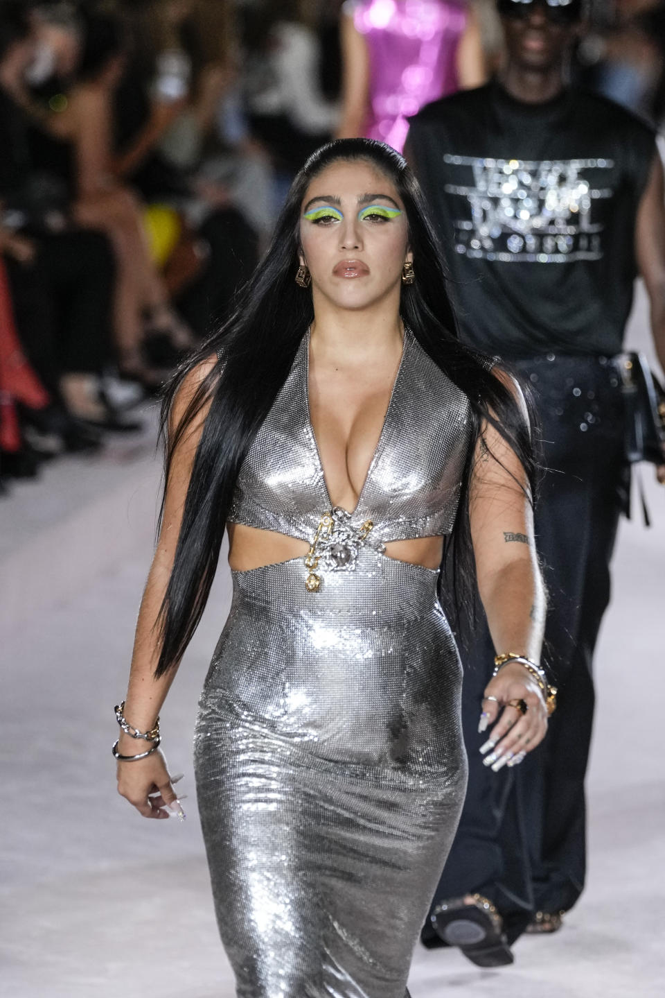 Lourdes Leon wears a creation for the Versace Spring Summer 2022 collection during Milan Fashion Week, in Milan, Italy, Friday, Sept. 24, 2021. (AP Photo/Luca Bruno)
