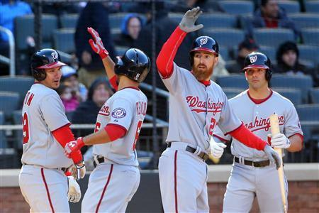 Mar 31, 2014; New York, NY, USA; Washington Nationals second baseman Anthony Rendon (6) celebrates his three run home run against the New York Mets during the tenth inning of an opening day baseball game at Citi Field. Washington Nationals won 9-7. Anthony Gruppuso-USA TODAY Sports