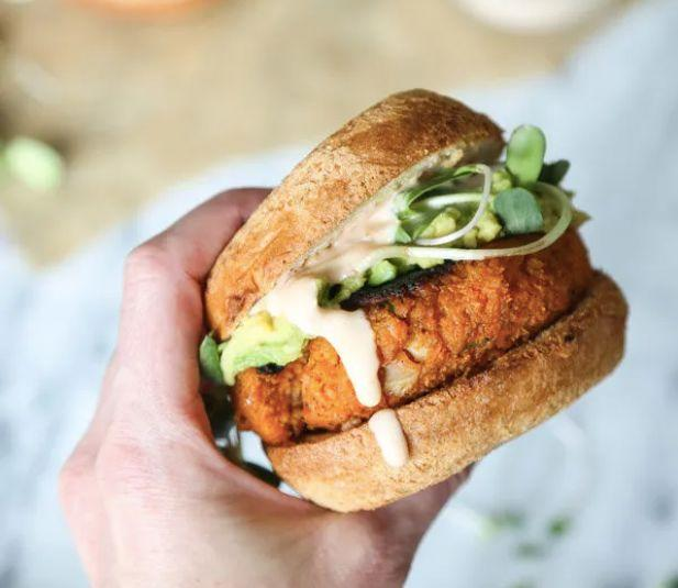 "<strong>Get the <a href=""https://feedmephoebe.com/cauliflower-sweet-potato-burgers-avocado-sriracha-aioli-vegetarian-paleo/"" target=""_blank"" rel=""noopener noreferrer"">Cauliflower Sweet Potato Burgers</a> recipe from Feed Me Phoebe</strong>"