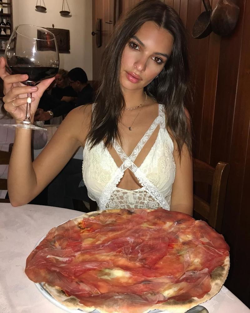 While in Milan, Emily Ratajkowski made sure to sample all the local delicacies, pizza and red wine obviously at the forefront.