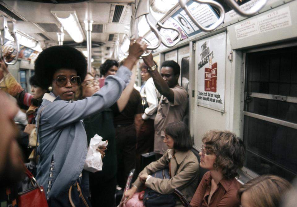 Riders in a subway car in 1976, complete with an iconic Lark cigarettes ad. Graffiti art—along with violence—began overtaking the subway in the 1970s; by the 1980s, more than 250 felonies were committed on the subway every week.