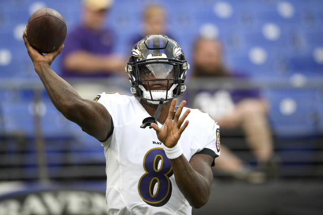 FILE - In this Thursday, Aug. 15, 2019 file photo, Baltimore Ravens quarterback Lamar Jackson works out prior to a NFL football preseason game against the Green Bay Packers in Baltimore. In an NFL landscape filled with strong-armed quarterbacks and high-scoring games, the Baltimore Ravens are kicking it old school. Second-year quarterback Lamar Jackson will probably be spending much of his time handing the football to free agent pickup Mark Ingram and Gus Edwards, who had a team-high 718 yards rushing last year. (AP Photo/Nick Wass, File)