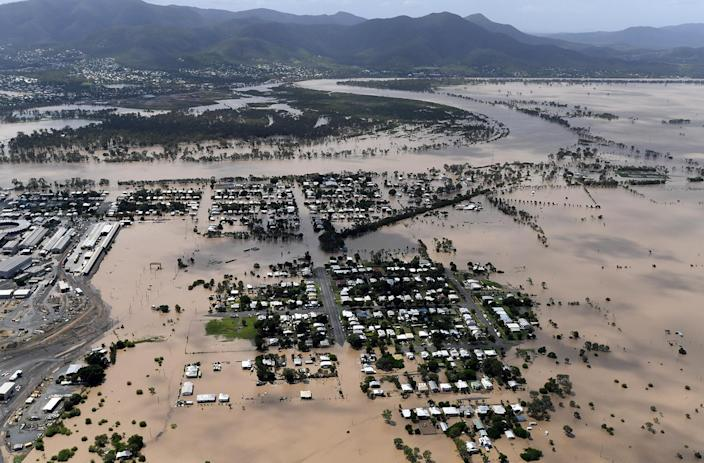 <p>Houses are surrounded by floodwaters in the aftermath of Cyclone Debbie at Depot Hill in Rockhampton, Australia, April 6, 2017. (Photo: AAP/Dan Peled/Reuters) </p>