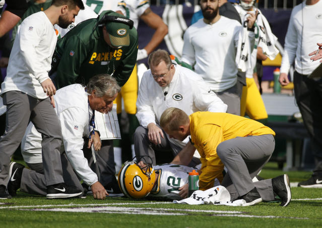 Green Bay Packers quarterback Aaron Rodgers broke his collarbone on a hit by Vikings linebacker Anthony Barr. (AP)