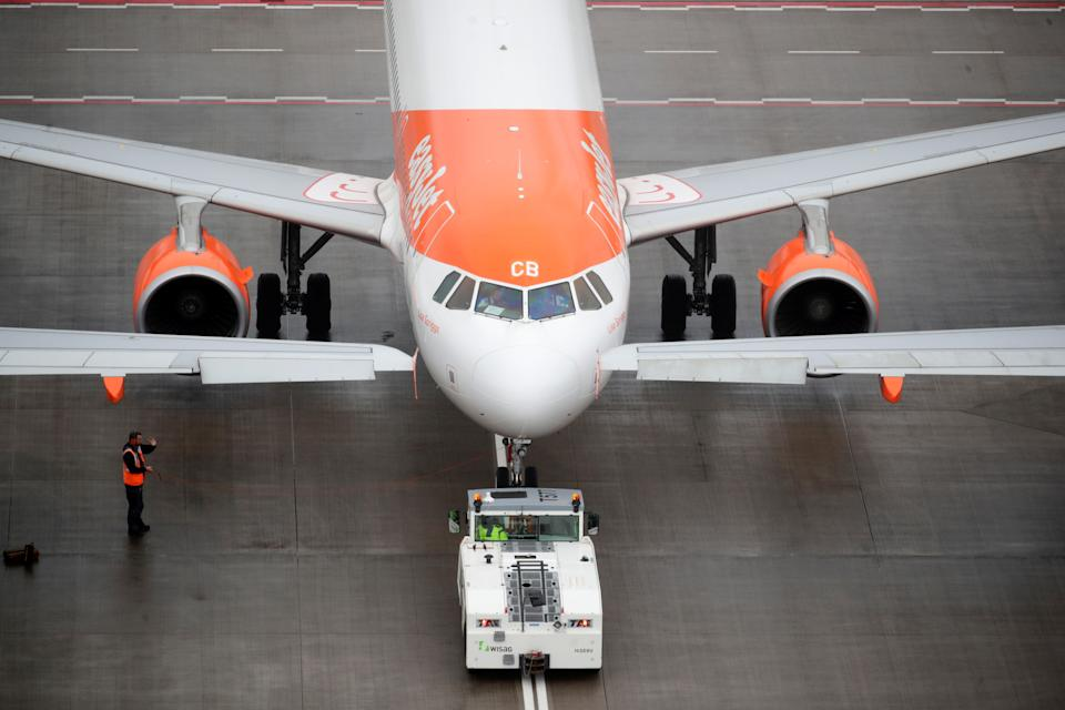 An EasyJet airplane is parked on the tarmac the new Berlin-Brandenburg Airport in Schoenefeld near Berlin, Germany. Photo: Hannibal Hanschke/Reuters