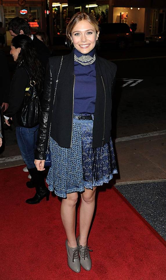 Apparently Mary-Kate's younger sister, actress Elizabeth, has caught the Olsen family fashion curse. Why do these young women insist on wearing granny-like getups to every A-list event they attend?!  (10/15/11)