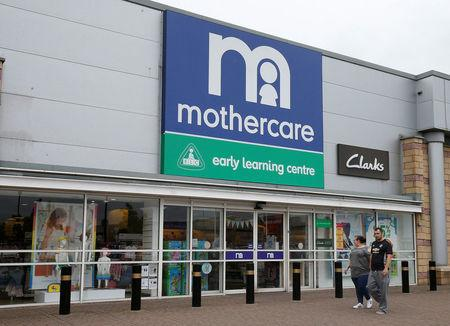 People walk past a Mothercare store in Altricham, Britain, May 16, 2018. REUTERS/Andrew Yates