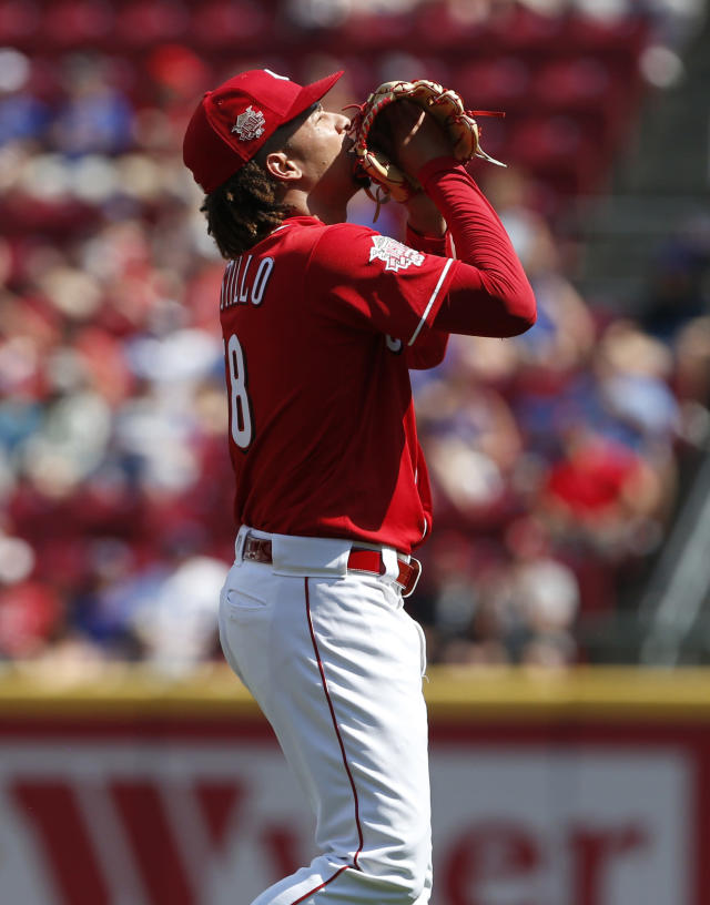 Cincinnati Reds starting pitcher Luis Castillo looks skyward after striking out the side during the first inning of a baseball game against the Chicago Cubs, Saturday, June 29, 2019, in Cincinnati. (AP Photo/Gary Landers)