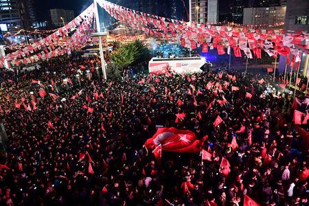Supporters of the main opposition Republican People's Party (CHP) gather in front of the party's headquarters to celebrate the municipal elections results in Ankara, Turkey, March 31, 2019. REUTERS/Stringer