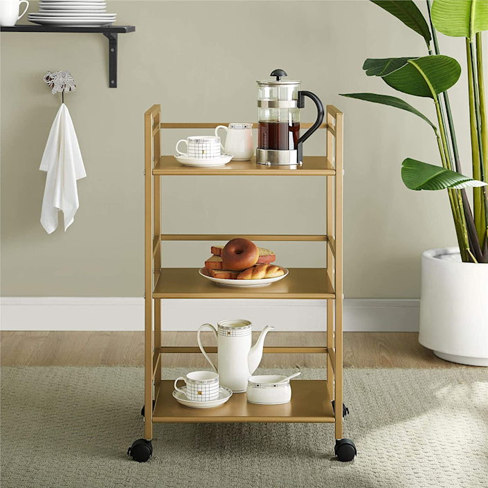 """<h3><strong>Amazon</strong></h3> <br><br><strong>Best For: Top-Rated Furniture <br></strong>The best part of this mega online-shopping destination's home offerings is the surprising selection of site-exclusive furniture and decor lines. From <a href=""""https://www.amazon.com/stores/page/DD889ED9-1597-416B-B17D-F074D9557EA8?ingress=2&visitId=2b152883-0505-4bd5-98a9-3c12342f8346&ref_=bl_dp_s_web_7633572011"""" rel=""""nofollow noopener"""" target=""""_blank"""" data-ylk=""""slk:Rivet"""" class=""""link rapid-noclick-resp"""">Rivet</a> to <a href=""""https://www.amazon.com/stores/node/17384727011?_encoding=UTF8&field-lbr_brands_browse-bin=Stone%20%26%20Beam&ref_=bl_dp_s_web_17384727011"""" rel=""""nofollow noopener"""" target=""""_blank"""" data-ylk=""""slk:Stone & Beam"""" class=""""link rapid-noclick-resp"""">Stone & Beam</a> and <a href=""""https://www.amazon.com/stores/node/18078648011?_encoding=UTF8&field-lbr_brands_browse-bin=Now%20House%20by%20Jonathan%20Adler&ref_=bl_dp_s_web_18078648011"""" rel=""""nofollow noopener"""" target=""""_blank"""" data-ylk=""""slk:trendy designer collaborations"""" class=""""link rapid-noclick-resp"""">trendy designer collaborations</a> (here's lookin' at you, <a href=""""https://www.amazon.com/stores/node/18078648011?_encoding=UTF8&field-lbr_brands_browse-bin=Now%20House%20by%20Jonathan%20Adler&ref_=bl_dp_s_web_18078648011"""" rel=""""nofollow noopener"""" target=""""_blank"""" data-ylk=""""slk:Jonathan Adler"""" class=""""link rapid-noclick-resp"""">Jonathan Adler</a>), decorating your space on Amazon opens up endless style possibilities all within flexible budgetary bounds.<br><br><strong><em><a href=""""https://www.amazon.com/home-garden-kitchen-furniture-bedding/b?ie=UTF8&node=1055398"""" rel=""""nofollow noopener"""" target=""""_blank"""" data-ylk=""""slk:Shop Amazon"""" class=""""link rapid-noclick-resp"""">Shop Amazon</a></em></strong><br><br><strong>Novogratz Collection</strong> Helix Utility Cart, Gold, $, available at <a href=""""https://www.amazon.com/dp/B07G51X8QV/ref=dp_prsubs_1"""" rel=""""nofollow noopener"""" target=""""_blank"""" data-ylk=""""slk:Amazon"""" class=""""link rapid-noclick-r"""