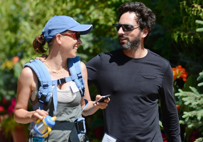 SUN VALLEY, ID - JULY 12:  Sergey Brin (L), co-founder of Google and wife Anne Wojcicki  attend the Allen & Company Sun Valley Conference on July 12, 2012, in Sun Valley, Idaho. The conference has been hosted annually by the investment firm Allen & Company each July since 1983. The conference is typically attended by many of the world's most powerful media executives.  (Photo by Kevork Djansezian/Getty Images)