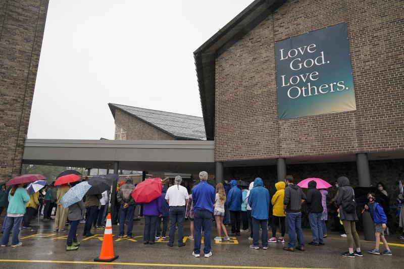 Churchgoers participate in a procession at the Holy Apostles Church in Milwaukee, Saturday, Sept. 12, 2020. For decades, Roman Catholic voters have been a pivotal swing vote in U.S. presidential elections, with a majority backing the winner, whether Republican or Democrat, nearly every time. (AP Photo/Morry Gash)