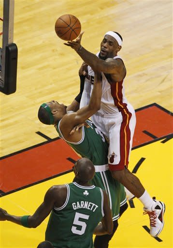Miami Heat's LeBron James (6) drives to the basket over Boston Celtics' Paul Pierce (34) during the second half of Game 7 of the NBA basketball playoffs Eastern Conference finals, Saturday, June 9, 2012, in Miami. At bottom is Kevin Garnett (5). AP Photo/Wilfredo Lee)
