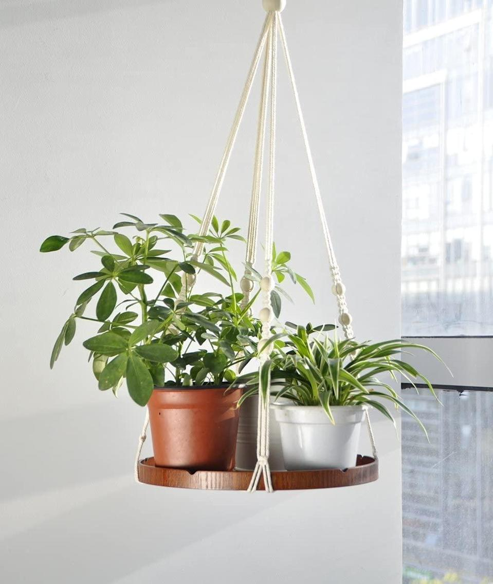 """<h2>Amazon Macrame Hanging Planter Shelf</h2> <br>Instead of repotting your favorite green friends, you can elevate them to new sunlight-reaching heights with this boho-chic macrame hanging shelf instead. <br><br><strong>TIMEYARD</strong> Macrame Hanging Planter Shelf, $, available at <a href=""""https://amzn.to/2QLxQKf"""" rel=""""nofollow noopener"""" target=""""_blank"""" data-ylk=""""slk:Amazon"""" class=""""link rapid-noclick-resp"""">Amazon</a><br>"""
