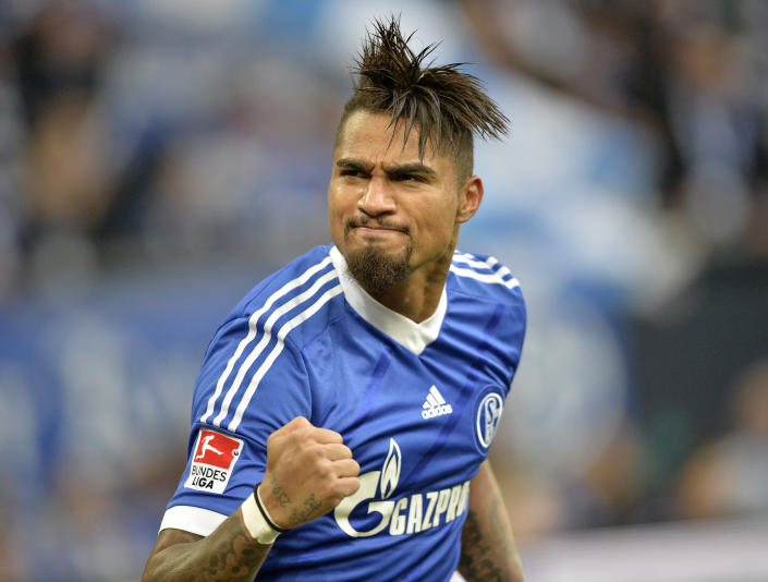 Schalke's Kevin-Prince Boateng of Ghana celebrates after the opening goal during the German Bundesliga soccer match between FC Schalke 04 and VfL Wolfsburg in Gelsenkirchen, Germany, Saturday, Feb. 1, 2014. (AP Photo/Martin Meissner)