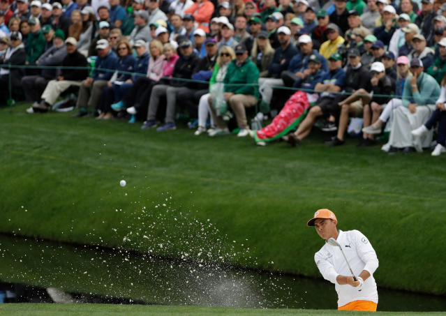 Rickie Fowler hits from a bunker on the 16th hole during the fourth round at the Masters golf tournament Sunday, April 8, 2018, in Augusta, Ga. (AP Photo/Matt Slocum)