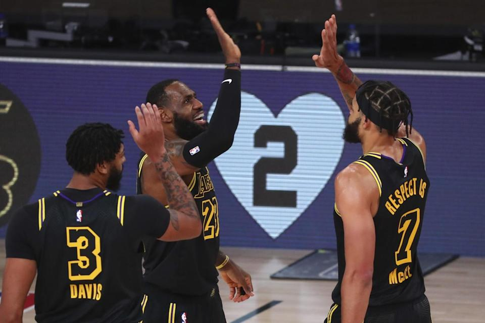 Lakers forward LeBron James celebrates after scoring a three-point basket.