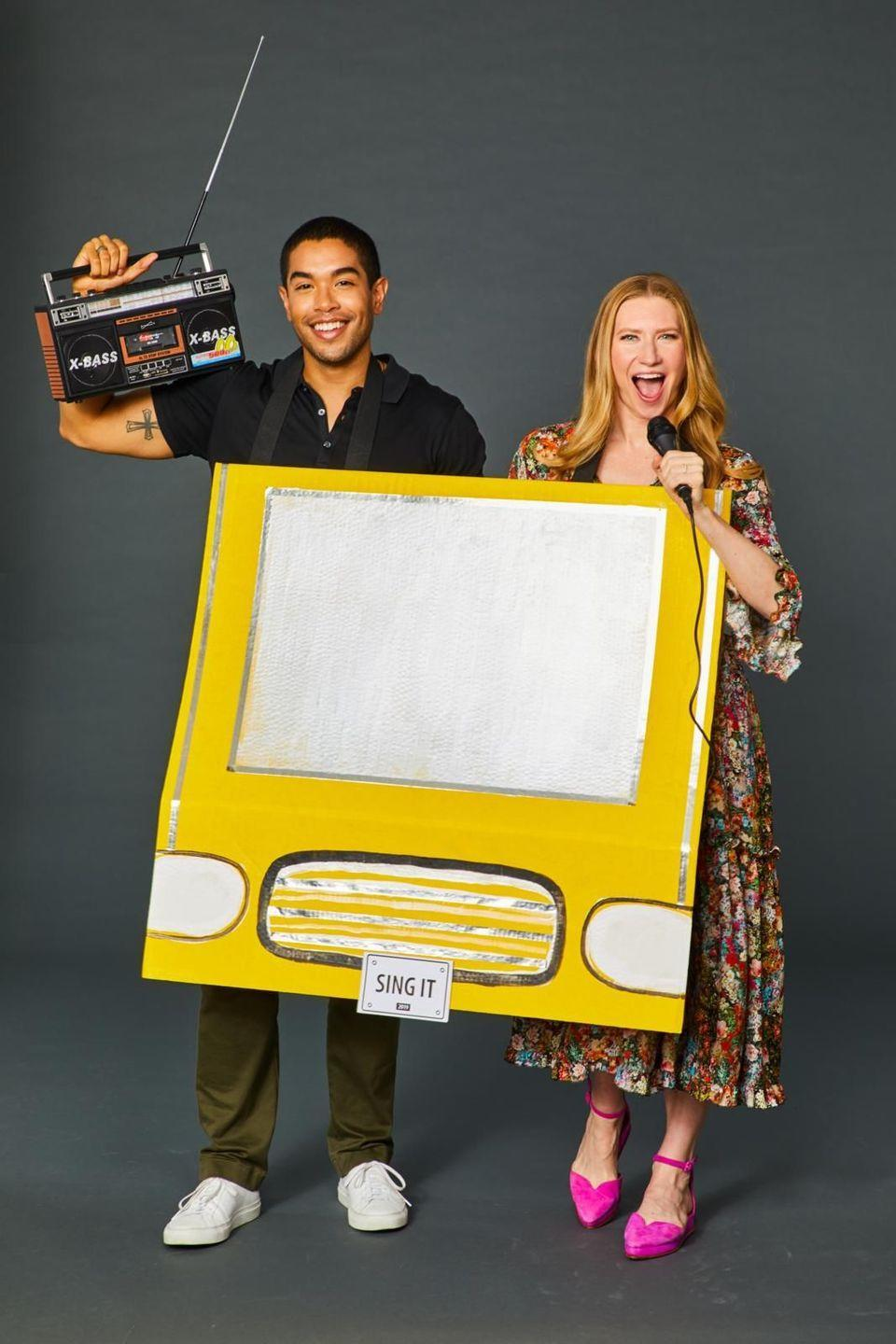 """<p>Use silver and black paint to transform yellow presentation board into a taxi. Then, attach velcro strips to make straps that can go around your necks. Brainstorm a clever vanity plate — """"Sing it,"""" for example — and finish it off with a boom box and microphone.</p><p><a class=""""link rapid-noclick-resp"""" href=""""https://www.amazon.com/JENSEN-CD-490-Portable-Stereo-Player/dp/B00BCA40S0/?tag=syn-yahoo-20&ascsubtag=%5Bartid%7C10055.g.21969310%5Bsrc%7Cyahoo-us"""" rel=""""nofollow noopener"""" target=""""_blank"""" data-ylk=""""slk:SHOP BOOM BOXES""""><strong>SHOP BOOM BOXES</strong></a></p>"""